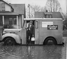 Milk Delivery On Flooded Street